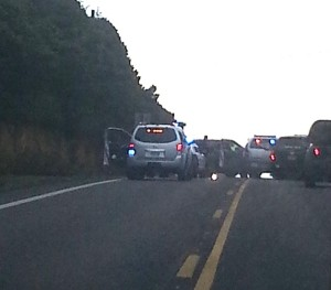Vehicles stopped on Huckleberry Hill just south of Ona Beach Loop.