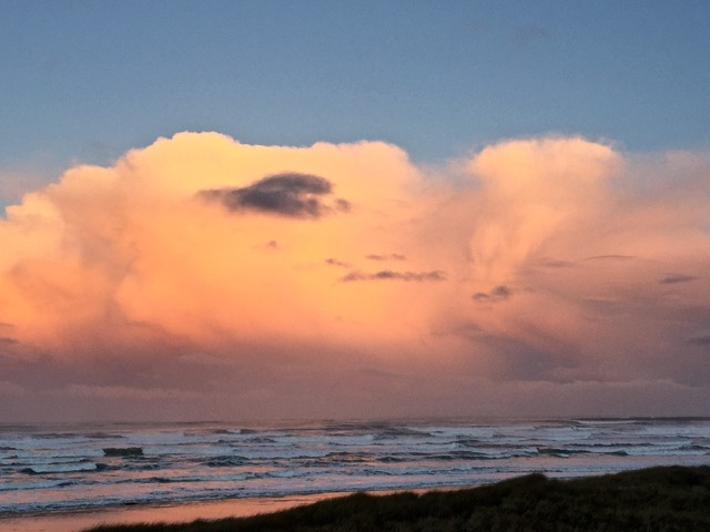 Massive dark pink and light yellow clouds... South Beach
