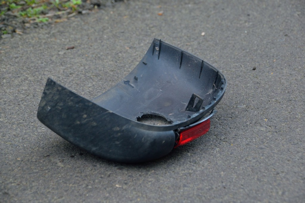 Piece of the passenger side mirror that broke off upon hitting the victim.