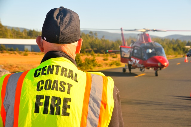 Central Coast Fire volunteer John O'brien watches the helicopter land.