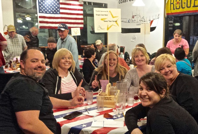 Who will take home 2016 bragging rights? Pictured here on their winning evening, the Oregon Coast Bank team took top honors at the 2015 Altrusa Trivia Bee and will be back to defend their title on April 16.