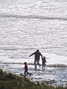 Father and children head for higher ground...with partially submerged logs not far behind them.