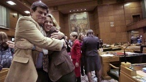 Rep. Vic Gilliam (R-Silverton) embraces friend and colleague Rep. Allisa Keny-Guyer (D-Portand) on the House floor. The Oregonian photo