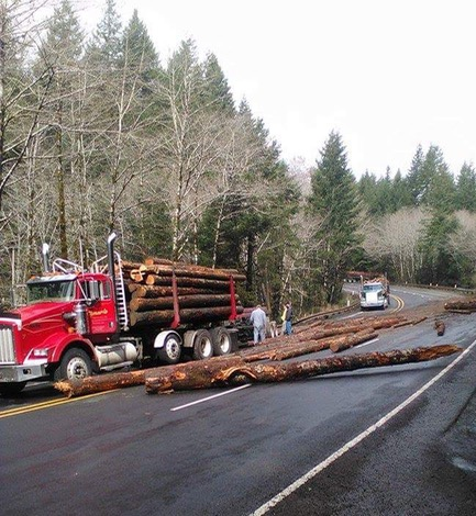 Cleanng up log truck accident on Siletz Highway. Hilda Haggard photo