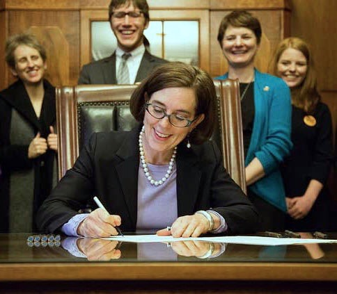 Governor Kate Brown signing Motor Voter law Courtesy photo
