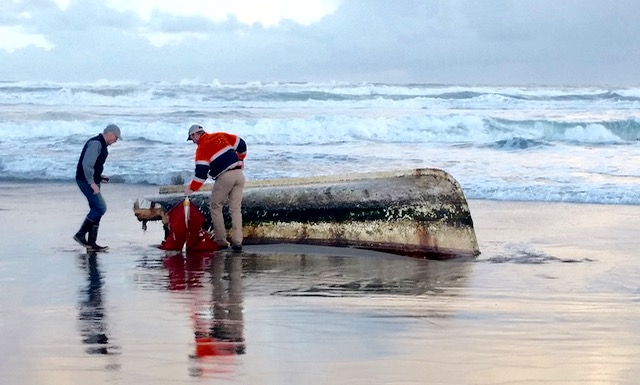 Tsunami boat lands on beach north of Coos Bay OS Parks photo