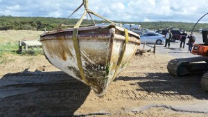Boat ready for transport to a landfill where it will be buried fairly deep to prevent any escape by endangered species to the outside world.