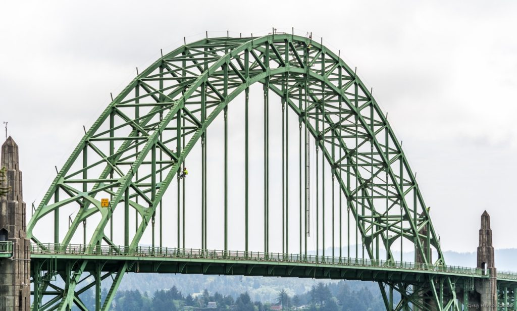 Center span of Yaquina Bay Bridge.  Somebody called 9-1-1 to say there was somebody up there looking like he's going to jump!