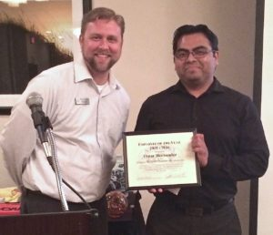 Omar Hernandez (right) with Newport Chamber Award of Employee of the Year! Chamber photo