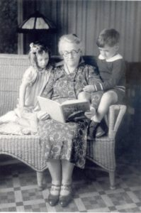 Louise B. Healy reads to her twin grandchildren, Jean and Joseph, in this 1933 photograph. (NLCHM photo archives)