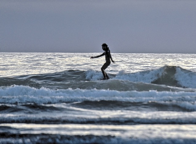 From afar this looked like a very feminine surfer.  Zoom in and we learned otherwise... Ken Gagne photo