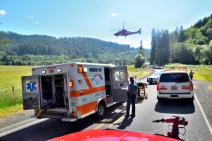 Victim aboard REACH chopper lifts off headed for Corvallis Trauma Center. Casey Wittmier/Central Oregon Coast Fire and Rescue District photo.