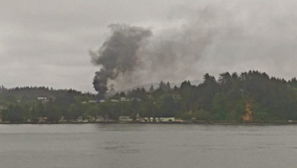 House fire can be seen from across the Alsea. Paul Williams photo