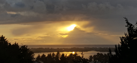 Same sunset from Bob O'Brien, Waldport City Councilor.  Looks like a huge iceberg mountain floating by!