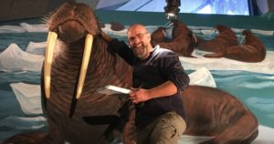 The mural transformed into a paper mache extension holding up two Walrus tusks!