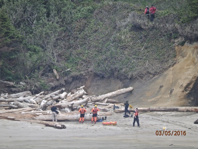 Body being prepared to be removed from the beach.  NLC reader photos