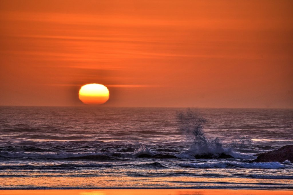 Sun paints everything red and orange - the sea struggles to remain a little blue! Ken Gagne
