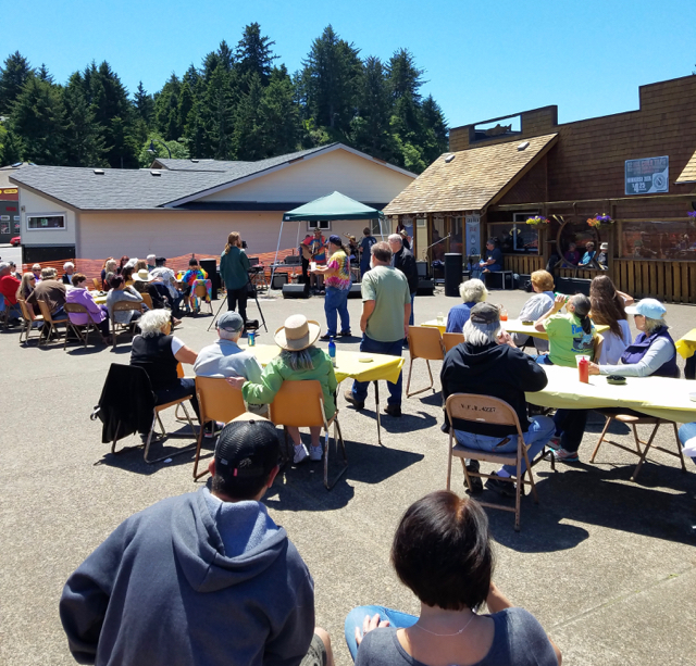 Soaking up some sun and great music in Waldport during Beachcombers days... Larry Miller photo