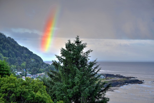 """God was busy making another beauty when the phone rang.  It was Yachats City Hall reminding him to renew his business license. """"I'll be right down"""" he boomed leaving the rainbow unfinished."""