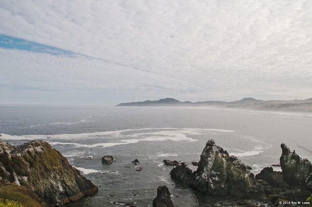 Yaquina Head on a very flat day...Cape Foulweather far north Roy Lowe photo