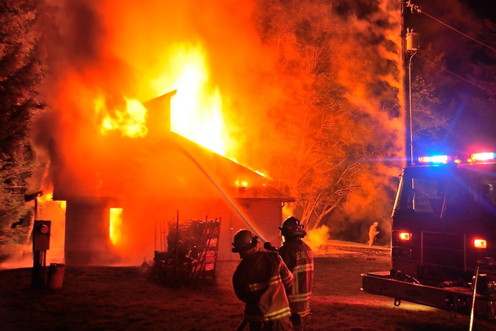 Firefighters went into defensive mode to protect the adjacent home.