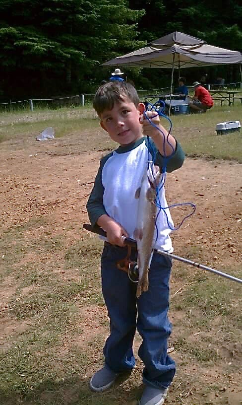 Benny enjoyed good luck fishing with Grandpa's (Todd Butterfield) pole!