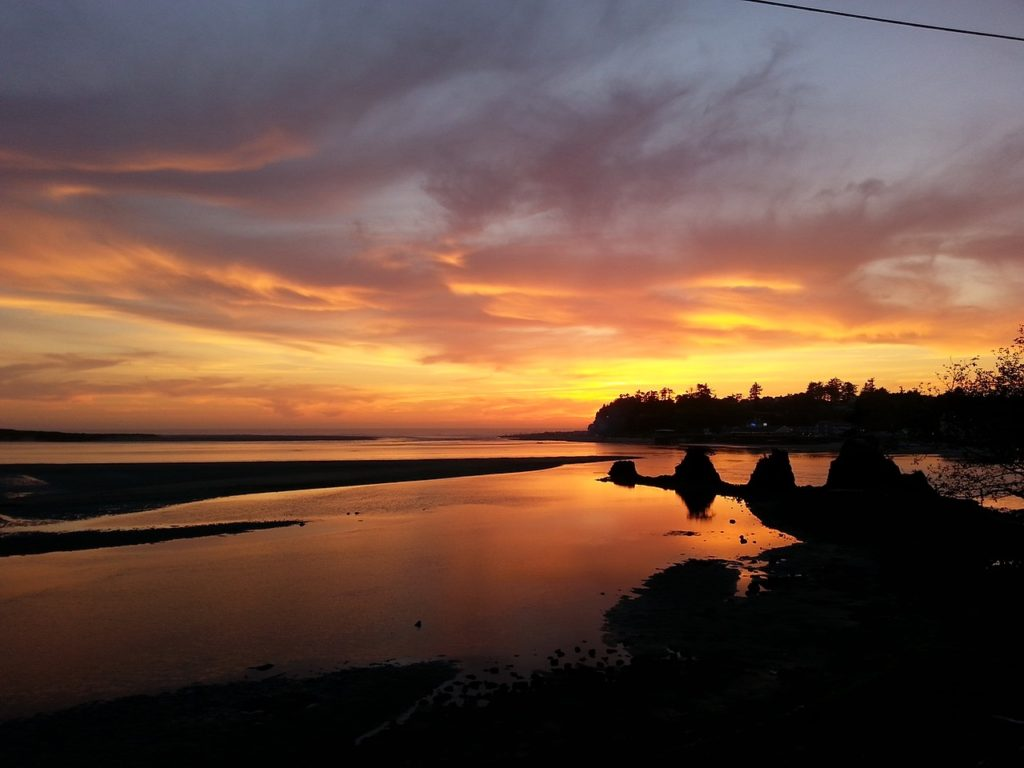 Sunset on Siletz Bay and the Four Sisters  off Drift Creek. Bea Ray photo