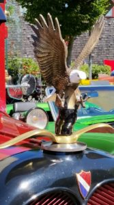 NOW!  That's a hood ornament!  at least you know no seagulls will get in your way on the highway...