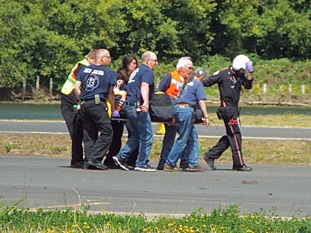 Fire Rescue crew help REACH paramedics load injured motorcycle rider for trip to trauma center in Corvallis.