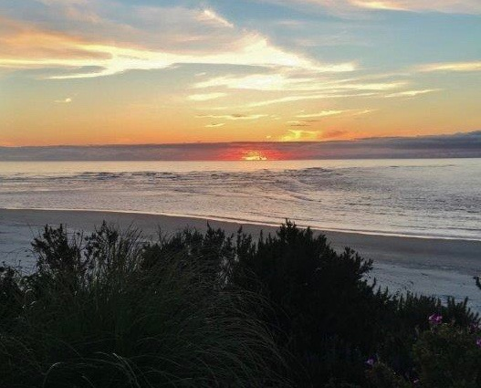 Sun burning a hole through the marine layer offshore. Sharon Robinson at Cliff House B&B, Waldport