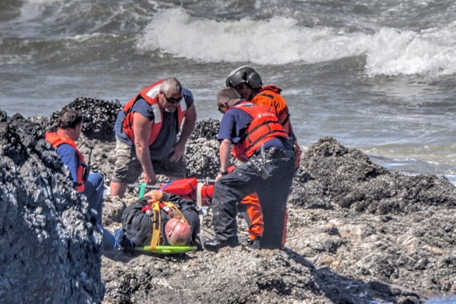 Coast Guard helps assess the victim who fell and badly broke his ankle
