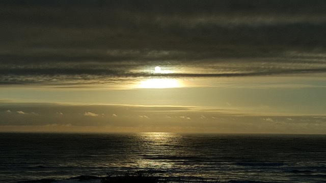 A metallic yellow sunset offshore from the gentle village of Waldport. Bob O'Brien photo
