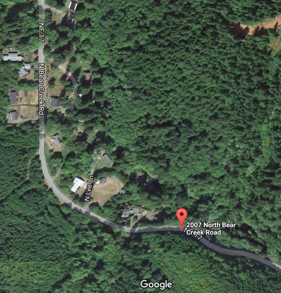 Older white Ford Ranger off North Bear Creek Road.  Driver likely deceased.