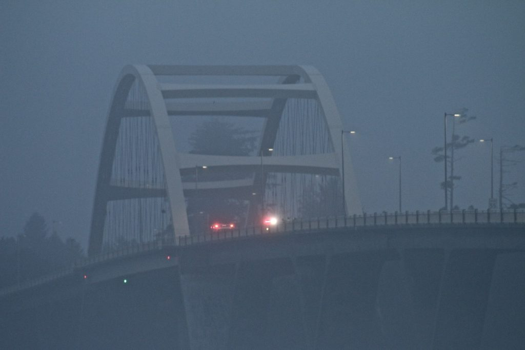 Alsea Bay Bridge Shortly after sunset in the fog Kim Mobley photo