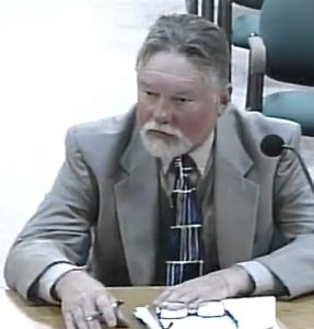 Speer Hoyt private attorney Russell Poppe with a finished criminal investigation being delivered to the Lincoln City City Council as requested by the council.