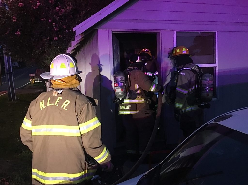 North Lincoln Firefighters rescue man inside a small sleeping area on NE 14th