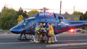 Woman occupant was quickly loaded aboard an awaiting LifeFlight air ambulance.