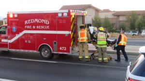 Driver was loaded aboard an ambulance bound for St. Charles Bend with obvious head and face lacerations.