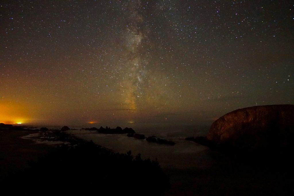Kerry Terrel shows us Waldport, Yachats and Florence with the Milky Way behind them.