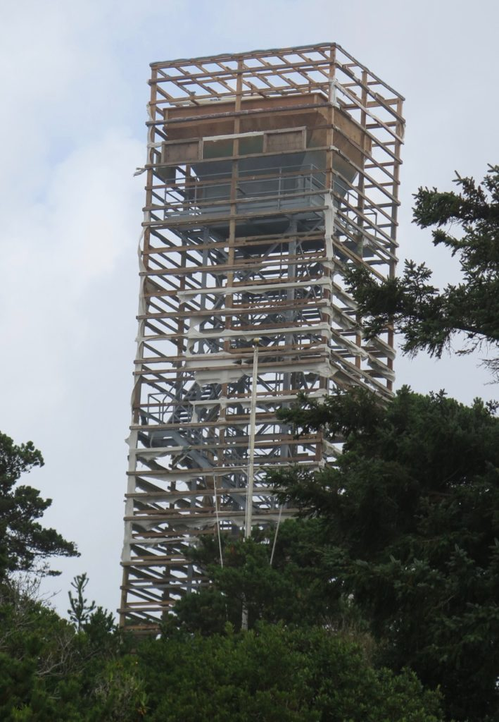 Relentless winds blew off the work cover on the Coast Guard's observation tower that's being renovated.