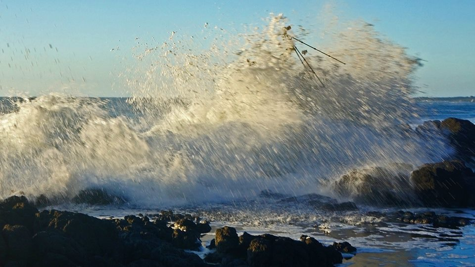 Photographer slammed by sneaker wave.  Notice camera tripod in the air. Cherise Glaze photos