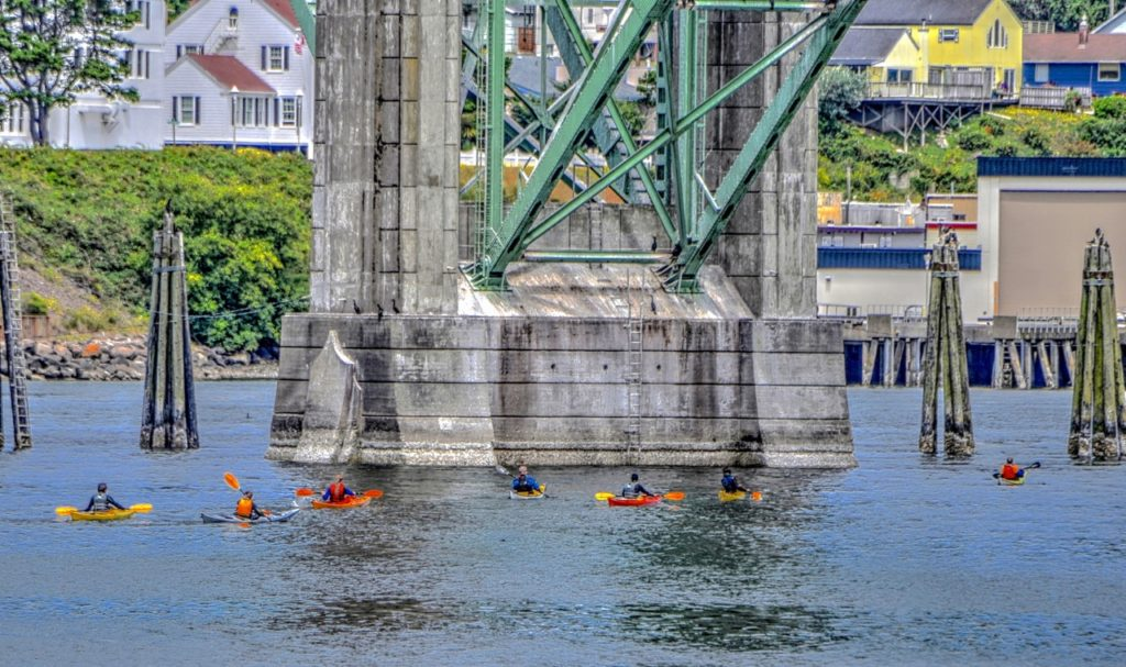 Kayakers under the Yaquina Bay Bridge Newport Ken Gagne