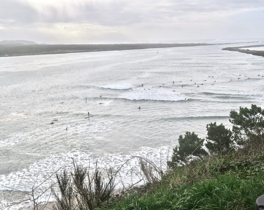 Waves along the coast are Yuuugge!  So the paddle boarders head into Yaquina Bay for their fun and Merriment! Sara Schreiber photos