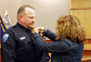NPD Officer Gary Welborn sworn in as Newport's newest Police Office - Wife Juanita pins his new badge on his uniform.